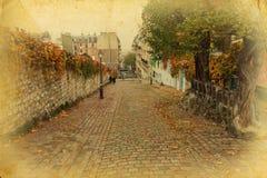 Δρόμος κυβόλινθων στο Παρίσι στο εκλεκτής ποιότητας ύφος στοκ φωτογραφίες με δικαίωμα ελεύθερης χρήσης