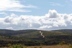 Δρόμος που οδηγεί στα σύννεφα Στοκ Εικόνες