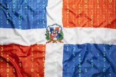 Δυαδικός κώδικας με τη σημαία Δομινικανής Δημοκρατίας, προστασία δεδομένων concep Στοκ Φωτογραφία