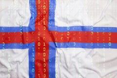 Δυαδικός κώδικας με τη σημαία Νησιών Φερόες, έννοια προστασίας δεδομένων Στοκ Φωτογραφία