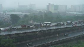 Δυνατή βροχή στην πόλη της Τζακάρτα απόθεμα βίντεο