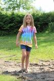 Δυσάρεστο κορίτσι στη λάσπη Στοκ Εικόνες