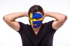 Δυστυχισμένος και αποτυχία του στόχου ή χάστε τις συγκινήσεις παιχνιδιών του οπαδού ποδοσφαίρου Σουηδού στην υποστήριξη παιχνιδιώ Στοκ Εικόνες