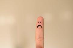 Δυστυχισμένο λυπημένο χέρι προσώπου που επισύρεται την προσοχή σε μια άκρη δάχτυλων Στοκ φωτογραφίες με δικαίωμα ελεύθερης χρήσης