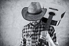 Δυτικός μουσικός κάουμποϋ χωρών με την κιθάρα Στοκ Εικόνες