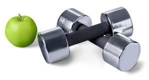 Δύο αλτήρες και Apple στο άσπρο υπόβαθρο Στοκ Φωτογραφία