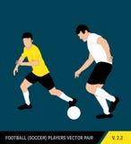 Δύο αντίπαλοι ποδοσφαίρου από τις διαφορετικές ομάδες παλεύουν για τη σφαίρα Ποδοσφαιριστές, ο υπερασπιστής και η πάλη επιτιθεμέν απεικόνιση αποθεμάτων