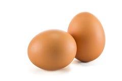 Δύο αυγά είναι απομονωμένα σε ένα άσπρο υπόβαθρο Στοκ Φωτογραφία