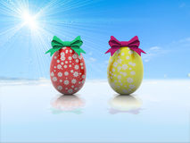 Δύο αυγά Πάσχας με τα τόξα δώρων τρισδιάστατα δίνουν Στοκ εικόνες με δικαίωμα ελεύθερης χρήσης