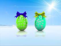 Δύο αυγά Πάσχας με τα τόξα δώρων τρισδιάστατα δίνουν Στοκ Φωτογραφία