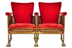 Δύο εκλεκτής ποιότητας καρέκλες κινηματογραφικών αιθουσών που απομονώνονται στο λευκό Στοκ Εικόνα