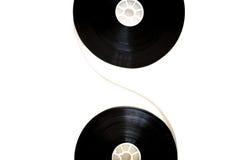 Δύο εξέλικτρα κινηματογράφων 35mm που συνδέονται με το filmstrip που απομονώνεται Στοκ Φωτογραφίες