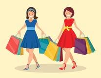 Δύο ευτυχείς γυναίκες πηγαίνουν μεγάλη πώληση στοκ εικόνα με δικαίωμα ελεύθερης χρήσης