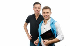 Δύο ευτυχείς τύποι και μια ταμπλέτα Εργασία και μελέτη Άσπρη ανασκόπηση Στοκ Εικόνες