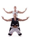 Δύο ισχυρά άτομα εμφανίζουν απόδοση χορού που απομονώνεται Στοκ Φωτογραφίες
