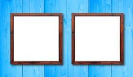 Δύο κενά ξύλινα πλαίσια στον τοίχο Άσπρο εσωτερικό και ανοικτό μπλε υπόβαθρο, διάστημα για το κείμενο Στοκ Εικόνα