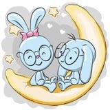 Δύο κουνέλια στο φεγγάρι διανυσματική απεικόνιση
