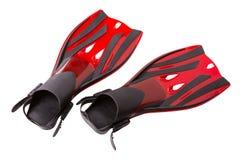 Δύο κόκκινα βατραχοπέδιλα για την κατάδυση σκαφάνδρων, σε ένα άσπρο υπόβαθρο στοκ εικόνες με δικαίωμα ελεύθερης χρήσης