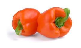 Δύο κόκκινα γλυκά πιπέρια που απομονώνονται στο λευκό Στοκ Εικόνες