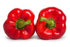 Δύο κόκκινα γλυκά πιπέρια που βρίσκονται το ένα δίπλα στο άλλο Στοκ εικόνες με δικαίωμα ελεύθερης χρήσης