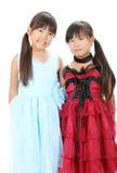 Δύο μικρά ασιατικά κορίτσια Στοκ Φωτογραφία