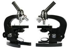 Δύο μικροσκόπια που απομονώνονται στο λευκό Στοκ Εικόνες