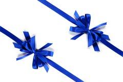 Δύο μπλε κορδέλλες με το τόξο Στοκ εικόνες με δικαίωμα ελεύθερης χρήσης