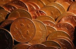 Δύο πένες νομισμάτων στη μηχανή διασκέδασης Στοκ Εικόνες