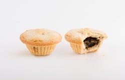 Δύο πίτες καρπού, μια που δαγκώνεται Στοκ Εικόνες