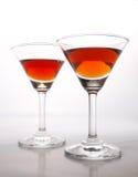 Δύο ποτήρια του κονιάκ που απομονώνεται σε ένα άσπρο υπόβαθρο Στοκ Εικόνες