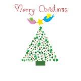 Δύο πουλιά βάζουν το αστέρι πάνω από το δέντρο Chirstmas με τη Χαρούμενα Χριστούγεννα λέξης Στοκ Φωτογραφίες