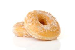 Δύο που συσσωρεύονται γλυκαμένος donuts πέρα από το άσπρο υπόβαθρο στοκ φωτογραφίες