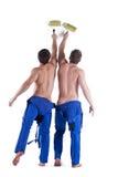 Δύο προκλητικοί ζωγράφοι στις μπλε φόρμες Στοκ φωτογραφία με δικαίωμα ελεύθερης χρήσης