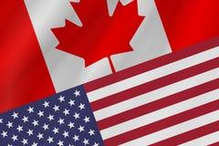 Δύο σημαίες χωρών του Καναδά και των Ηνωμένων Πολιτειών της Αμερικής στοκ εικόνες με δικαίωμα ελεύθερης χρήσης
