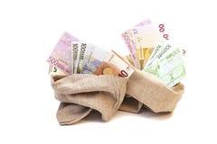 Δύο τσάντες χρημάτων με το ευρώ που απομονώνεται Στοκ Φωτογραφίες