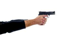 Δύο χέρια που κρατούν ένα πυροβόλο όπλο Στοκ εικόνα με δικαίωμα ελεύθερης χρήσης