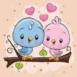 Δύο χαριτωμένα πουλιά κάθονται σε έναν κλάδο απεικόνιση αποθεμάτων