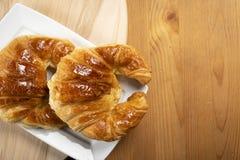 Δύο croissants για το πρόγευμα Στοκ Εικόνες
