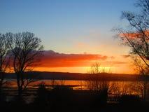 Δύση από το πορθμείο ενυδρίδων στο ηλιοβασίλεμα Στοκ Φωτογραφία