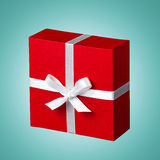 Δώρο ημέρας του κόκκινου βαλεντίνου που απομονώνεται στο μπλε Στοκ Εικόνα