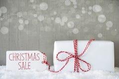 Δώρο, υπόβαθρο τσιμέντου με Bokeh, πώληση Χριστουγέννων κειμένων Στοκ εικόνες με δικαίωμα ελεύθερης χρήσης