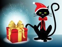 Δώρο Χριστουγέννων με το μαύρο santa γατών Στοκ Εικόνα
