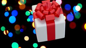 Δώρο Χριστουγέννων που μειώνεται και που αναπηδά στο άσπρο υπόβαθρο σε σε αργή κίνηση απόθεμα βίντεο