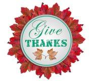 Δώστε τις ευχαριστίες που γράφονται στον κύκλο μέσα στο κόκκινο άσπρο υπόβαθρο φύλλων Στοκ φωτογραφία με δικαίωμα ελεύθερης χρήσης