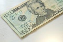 Είκοσι δολάρια με μια σημείωση 20 δολάρια Στοκ Εικόνες