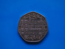 Είκοσι πένες νόμισμα, Ηνωμένο Βασίλειο πέρα από το μπλε Στοκ φωτογραφία με δικαίωμα ελεύθερης χρήσης