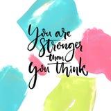 Είστε ισχυρότεροι από σκέφτεστε Κινητήριο ρητό στο καλλιτεχνικό υπόβαθρο κτυπημάτων χρωμάτων απεικόνιση αποθεμάτων