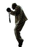 Εγκληματίας φυλακισμένων ατόμων με τη σκιαγραφία σφαιρών αλυσίδων Στοκ φωτογραφία με δικαίωμα ελεύθερης χρήσης