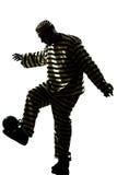 Εγκληματικό παίζοντας ποδόσφαιρο φυλακισμένων ατόμων με τη σκιαγραφία σφαιρών αλυσίδων Στοκ Εικόνα