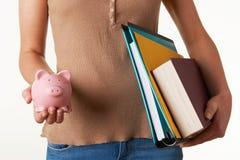Εγχειρίδια εκμετάλλευσης γυναικών σπουδαστών, αρχεία και τράπεζα Piggy στοκ φωτογραφία με δικαίωμα ελεύθερης χρήσης